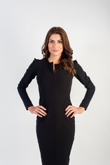 Portrait of a confident young business woman wearing black elegant dress and looking at camera!