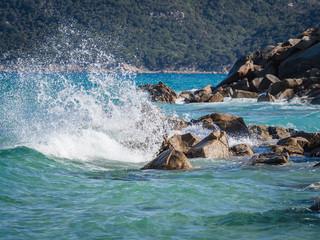 A wave breaking on the rocks.