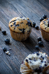homemade blueberry muffins on dark wood surface