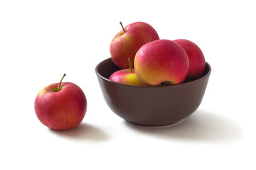 The apples in the brown bowl
