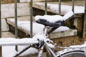Bike covered in snow, wintertime