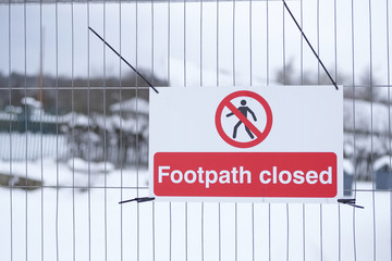 Footpath closed sign on fence at public country park Loch Lomond while construction work is in progress