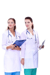 Two woman nurse watching X Ray image, standing in hospital. X Ray . Two woman doctor