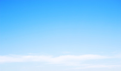 Blue sky background and white clouds soft focus, and copy-space