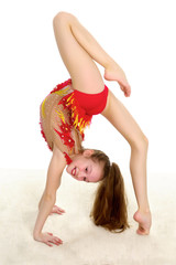 The gymnast performs a bridge with a raised leg.