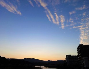Autumn clouds in twilight over historic town of Hitoyoshi, Japan