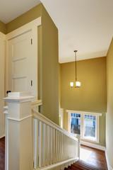 Hallway interior with green walls.