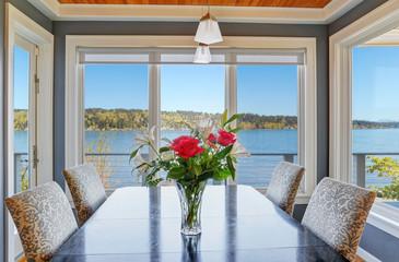 Light dining room with beautiful view of Lake Washington