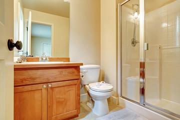 Open door to an en suite bathroom