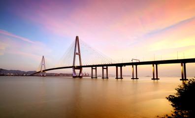 Landscape of the bridge over the sea at dusk