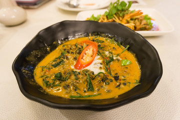 Close up traditional thai food red curry with Acasia