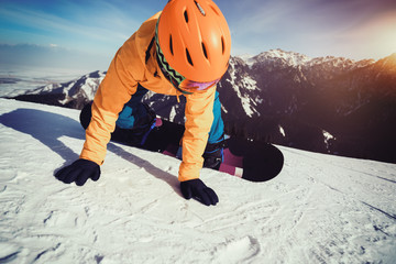 snowboarder snowboarding on winter mountain top slope