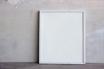 mockup of blank frame poster on wall