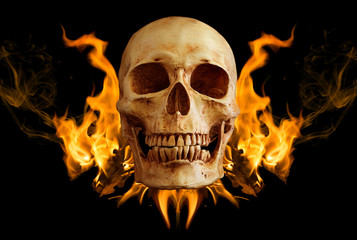 Skull on black cloth and black background.Skull in flame on black backgroundSkull in flame on black background / art image