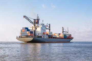 Cargo ship is sailing to sea to transport cargo in containers.Logistics and transportation of International , Freight Transportation, Shipping