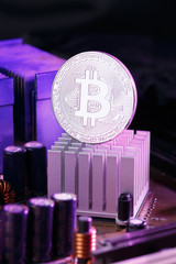 Picture of virtual currency, bitcoin and processor on pink background