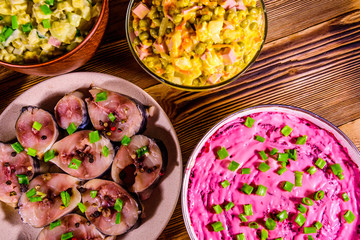 Different festive dishes on a wooden table. Top view