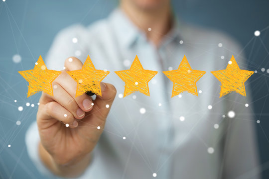 Businesswoman rating with hand drawn stars