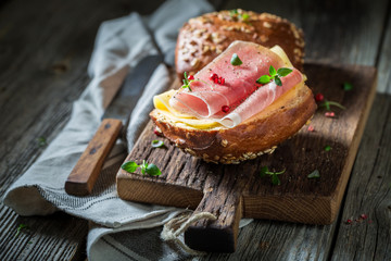Fresh bun with ham and cheese for breakfast