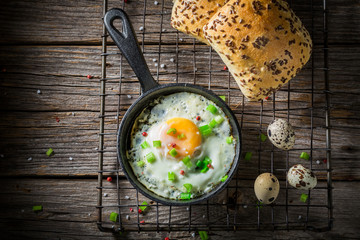 Aluminium Prints Egg Homemade fried eggs with chive and roll