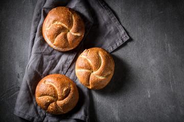 Delicious golden rolls on rustic linen napkin