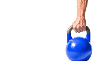 Strong muscular man hand with muscles holding dark blue heavy kettlebell partially isolated on white background