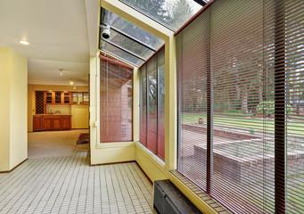 Light filled empty breakfast nook with window wall