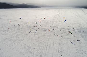 Kite boarders and kite skiers compete on the ice-covered Yenisei River outside Krasnoyarsk