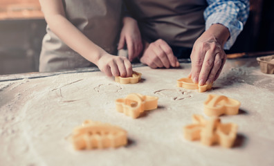 Grandmother and granddaughter cooking on kitchen