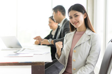 Business beauty woman wearing suit, looking  project. Open space loft office. Panoramic windows background.She happy and smile.