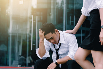 Businessman stress about work and partner asisstant soothe.