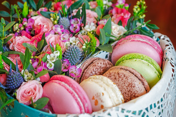 Macaroons in gift box with flowers