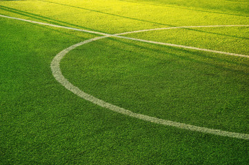 white circle line on green grass of football of soccer sport field background