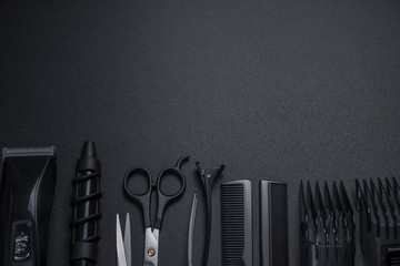 tools for cutting hair on a black background Wall mural