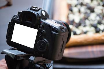 Close up   DSLR camera and white frame. (selective Focus)