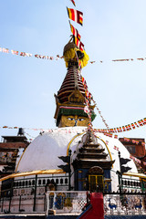 Stupa in Kathmandu, Nepal. Stupa is a mound-like or hemispherical structure containing relics that is used as a place of meditation.