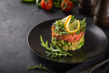 delicious avocado and salted salmon tartar, served with arugula