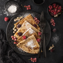 crepes with  frozen berries and powdered sugar