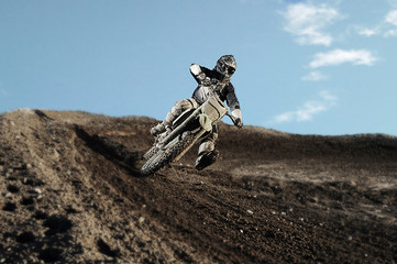 Motocross rider on race track