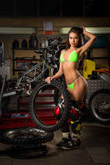 Sexy girl in garage with bike tires