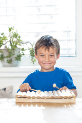 pretty boy is playing xylophone
