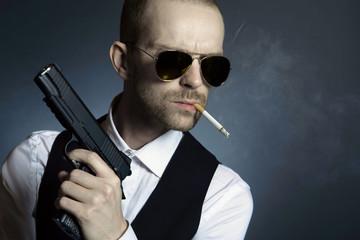 Mysterious man holding up gun