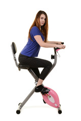 young woman riding an exercise bike