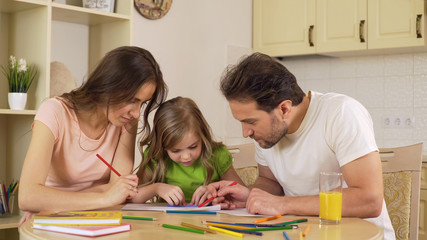 Happy family painting together, loving parents enjoying leisure with daughter