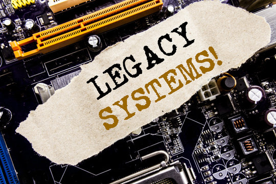 Handwriting Announcement text showing Legacy Systems. Business concept for Upgrade SOA Application Written on sticky note, computer main board background.
