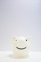 Smile Piggy bank on white desk for imaging to bright