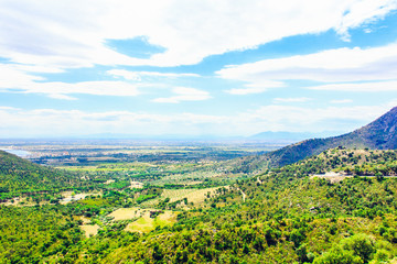 Natural landscape with mountains, groves, green forest and valley. Panoramic view of Mediterranean nature, Girona, Catalonia, Spain.