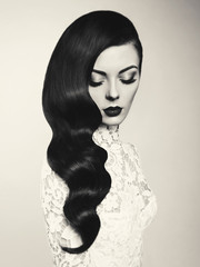 Beautiful woman with hairstyle Hollywood wave