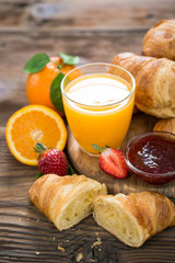 Fresh homemade croissants with orange juice