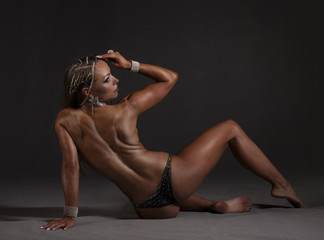 Muscular young woman athlete with perfect body